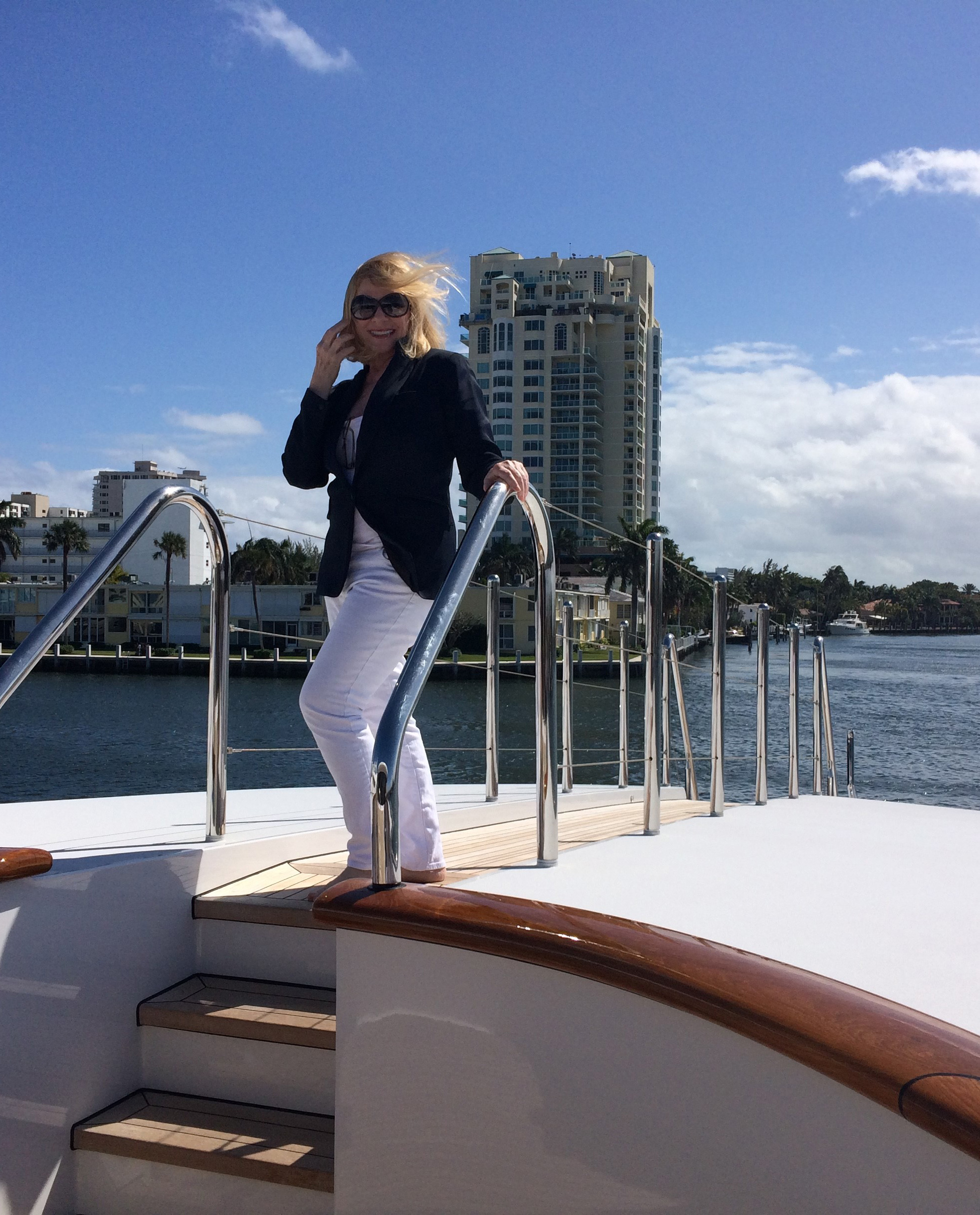 Rebecca Riley on the bow of a luxury yacht